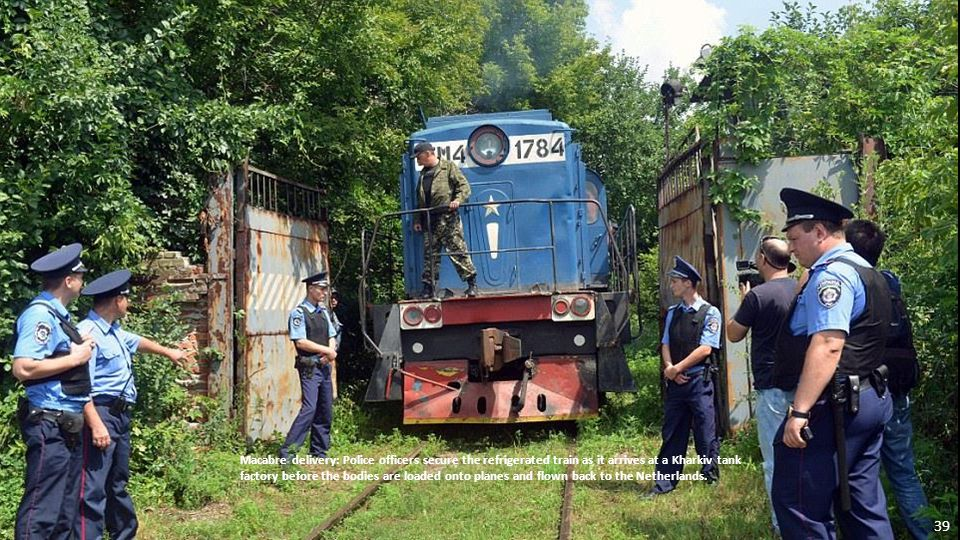 A train carrying bodies of the MH17 victims arrives in the Ukrainian city of Kharkiv. 38
