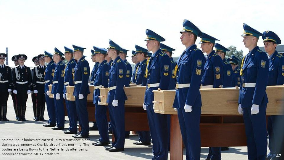 Tribute: Ukrainian officials attend a farewell ceremony next the transport plane that will be used to carry the remains of some of the victims of MH17