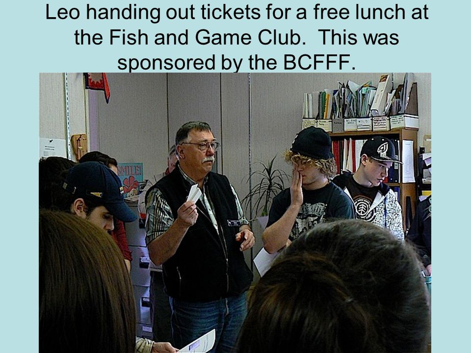 Leo handing out tickets for a free lunch at the Fish and Game Club.