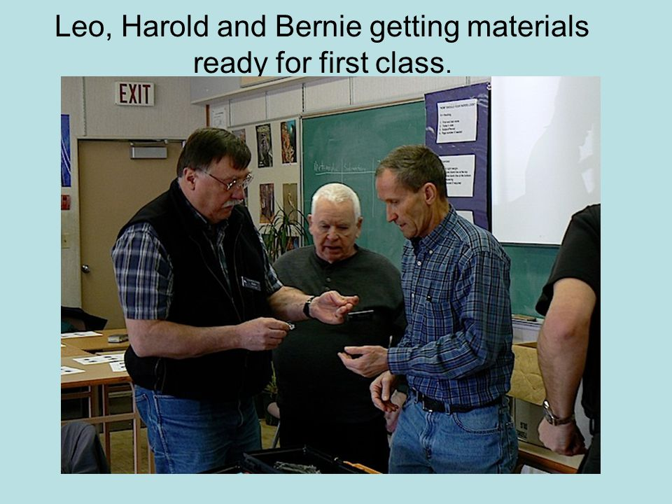 Leo, Harold and Bernie getting materials ready for first class.