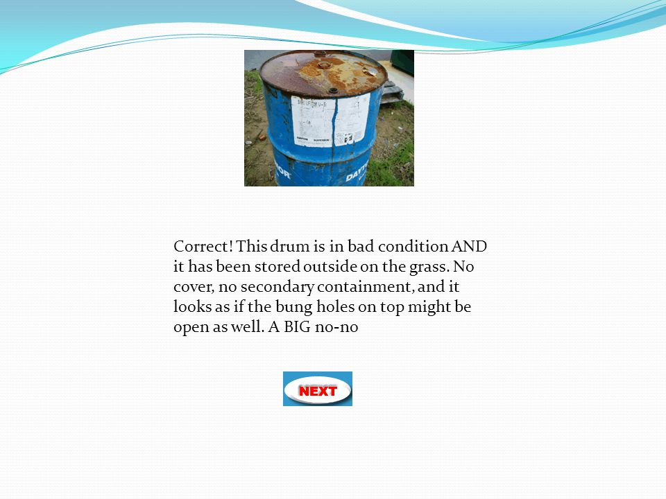 Correct! This drum is in bad condition AND it has been stored outside on the grass. No cover, no secondary containment, and it looks as if the bung ho
