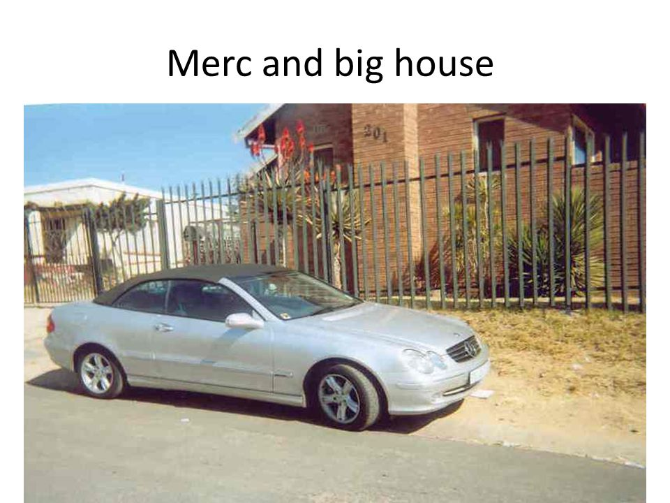 Merc and big house