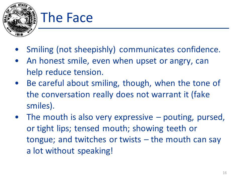The Face Smiling (not sheepishly) communicates confidence.