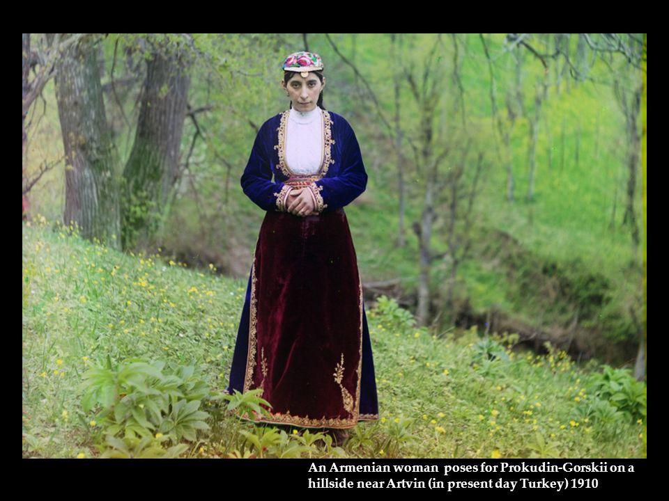 An Armenian woman poses for Prokudin-Gorskii on a hillside near Artvin (in present day Turkey) 1910