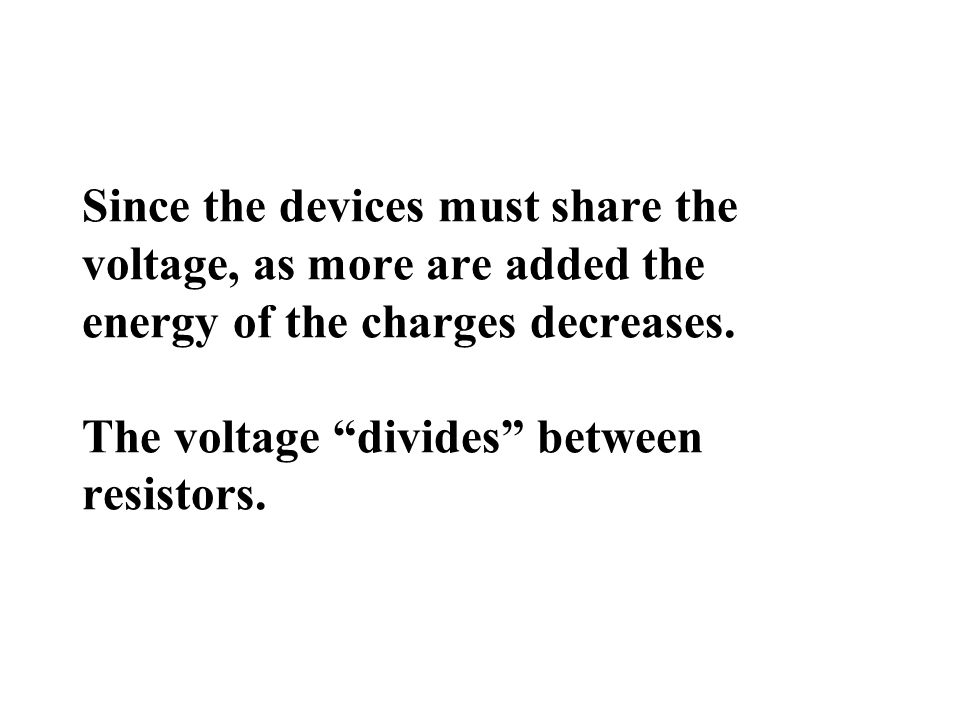 Since the devices must share the voltage, as more are added the energy of the charges decreases.