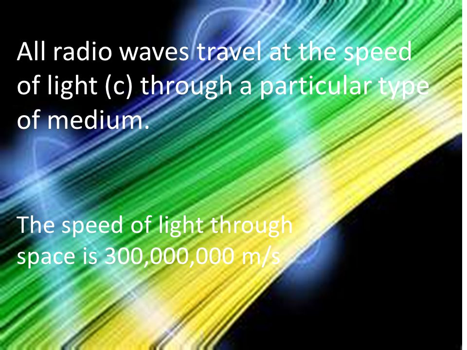 All radio waves travel at the speed of light (c) through a particular type of medium.