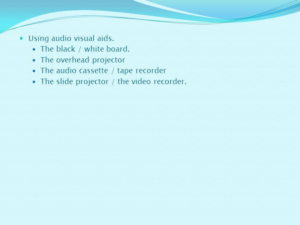 Using audio visual aids.The black / white board.