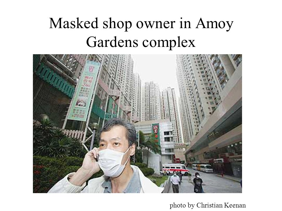 Masked shop owner in Amoy Gardens complex photo by Christian Keenan