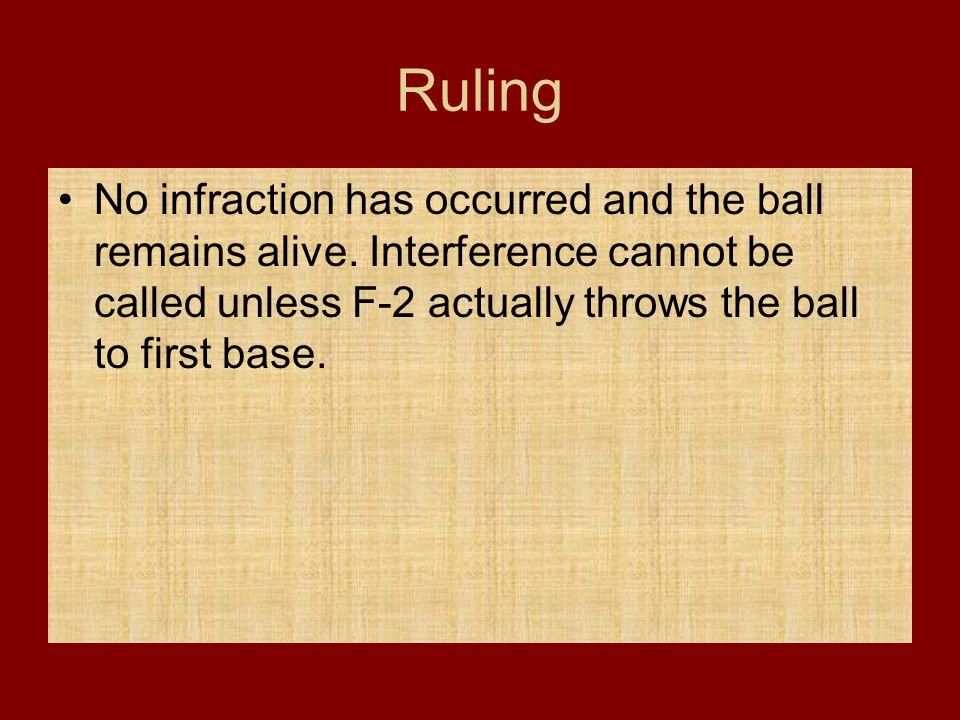 Ruling No infraction has occurred and the ball remains alive. Interference cannot be called unless F-2 actually throws the ball to first base.