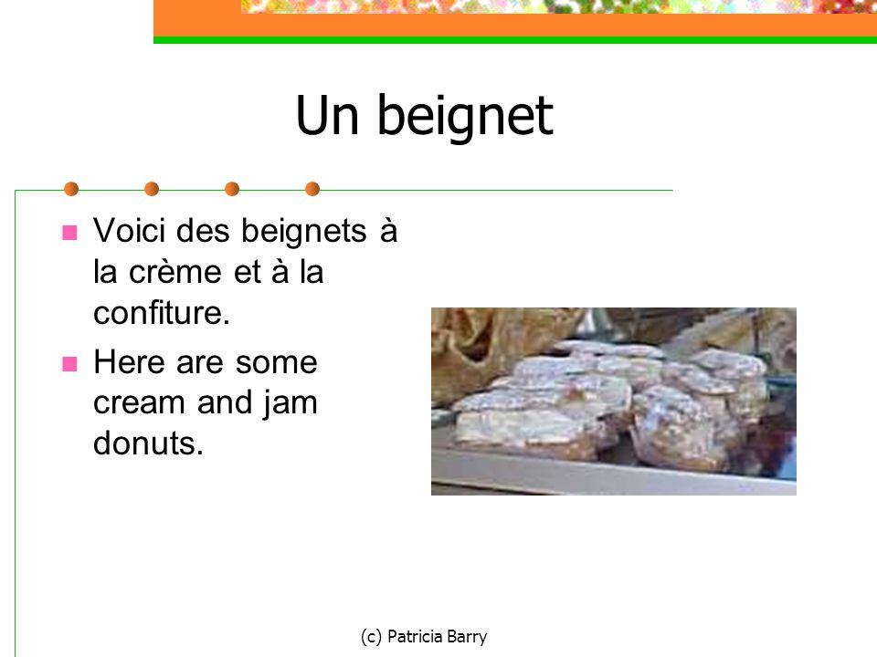 (c) Patricia Barry Un beignet Voici des beignets à la crème et à la confiture.