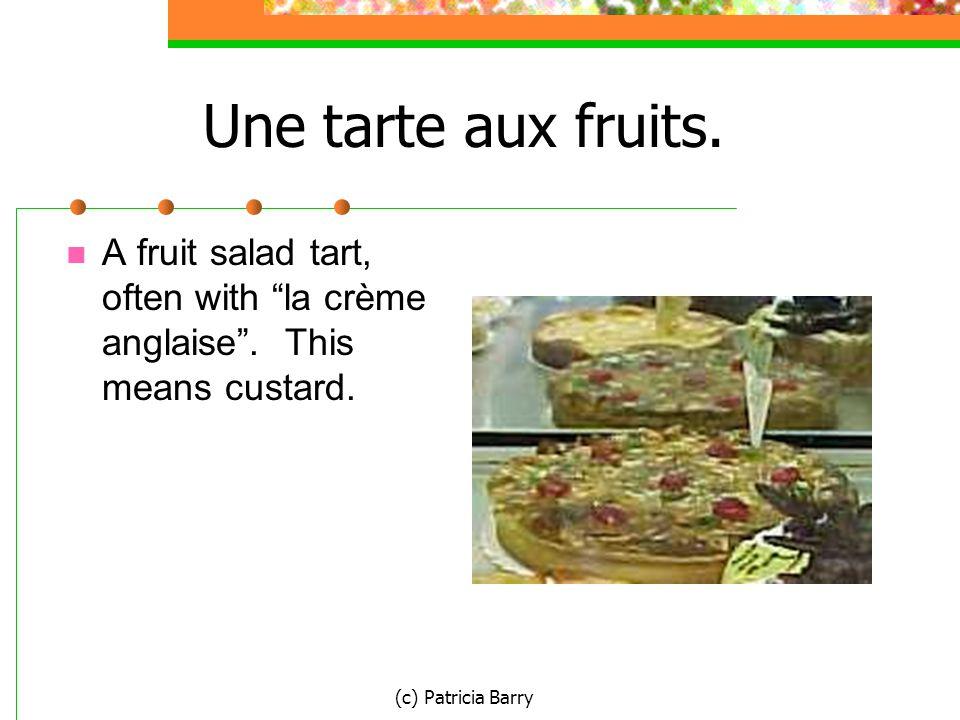 (c) Patricia Barry Une tarte aux fruits. A fruit salad tart, often with la crème anglaise .