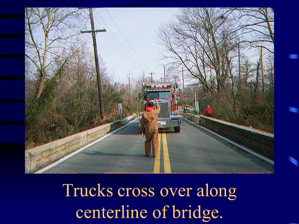 Trucks cross over along centerline of bridge.