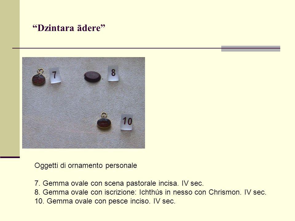 Oggetti di ornamento personale 7. Gemma ovale con scena pastorale incisa.