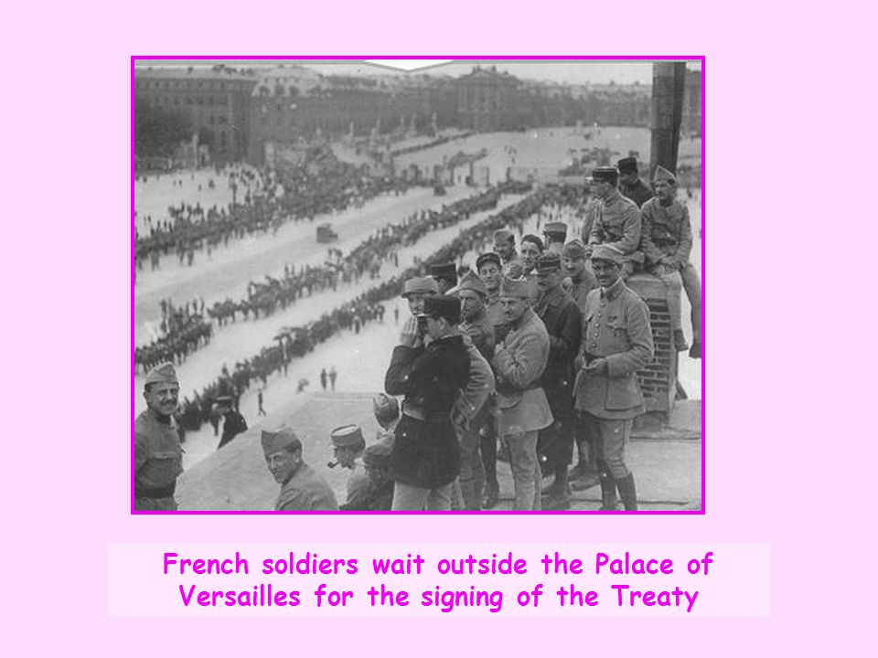 French soldiers wait outside the Palace of Versailles for the signing of the Treaty