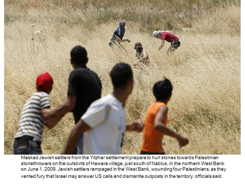 Masked Jewish settlers from the Yitzhar settlement prepare to hurl stones towards Palestinian stonethrowers on the outskirts of Hawara village, just south of Nablus, in the northern West Bank on June 1, 2009.