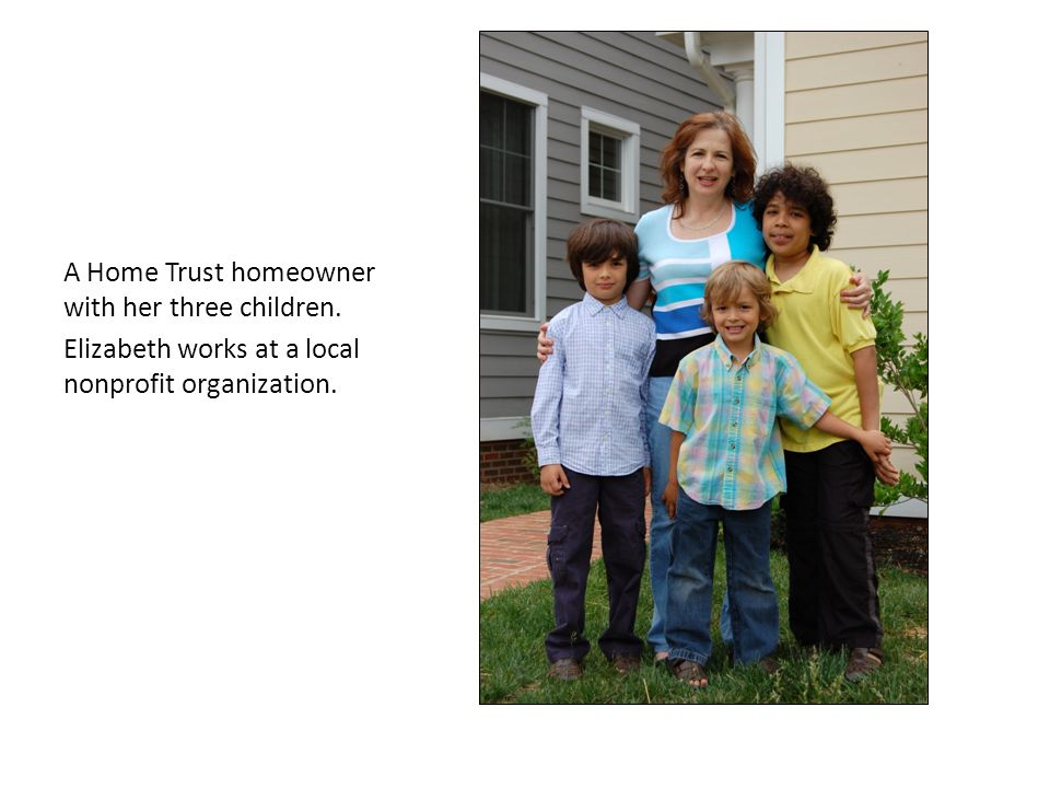 A Home Trust homeowner with her three children. Elizabeth works at a local nonprofit organization.