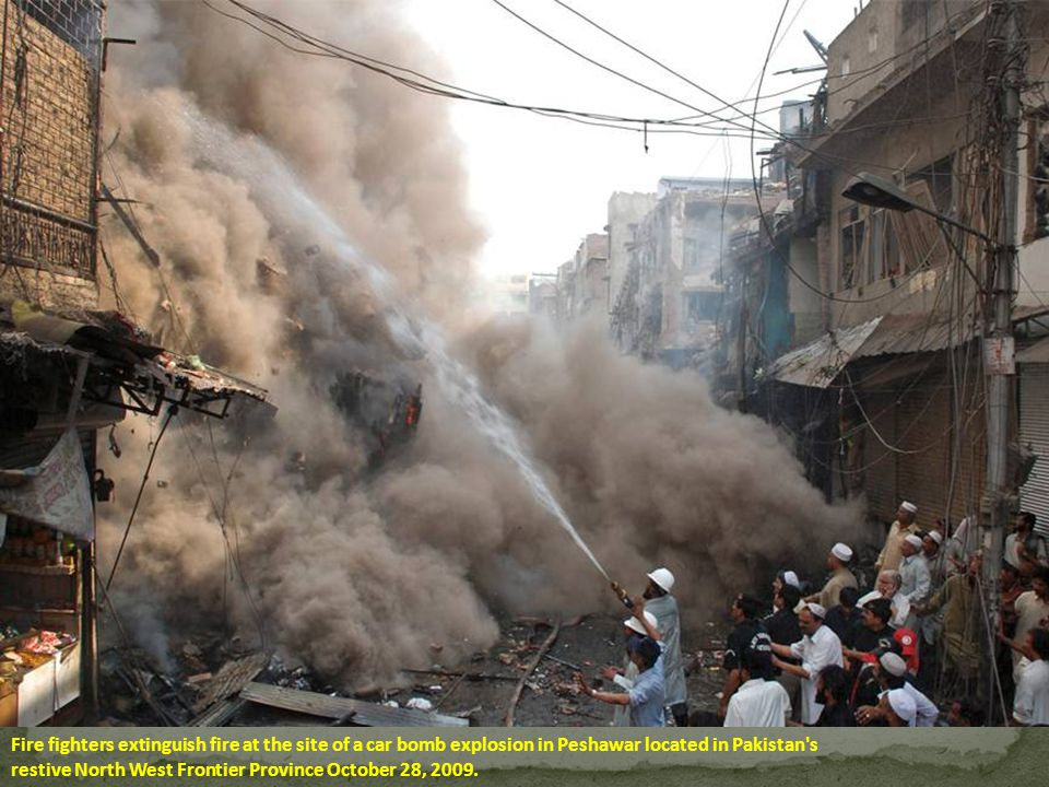 Fire fighters extinguish fire at the site of a car bomb explosion in Peshawar located in Pakistan s restive North West Frontier Province October 28, 2009.
