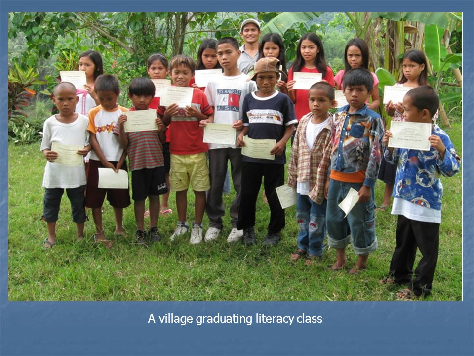 A village graduating literacy class