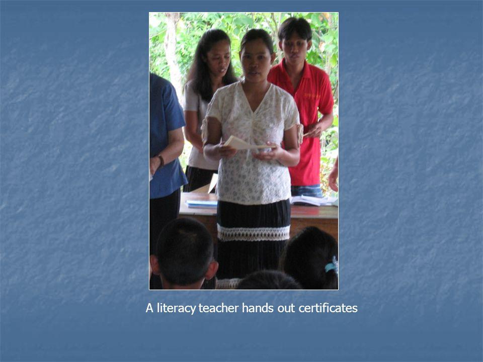 A literacy teacher hands out certificates