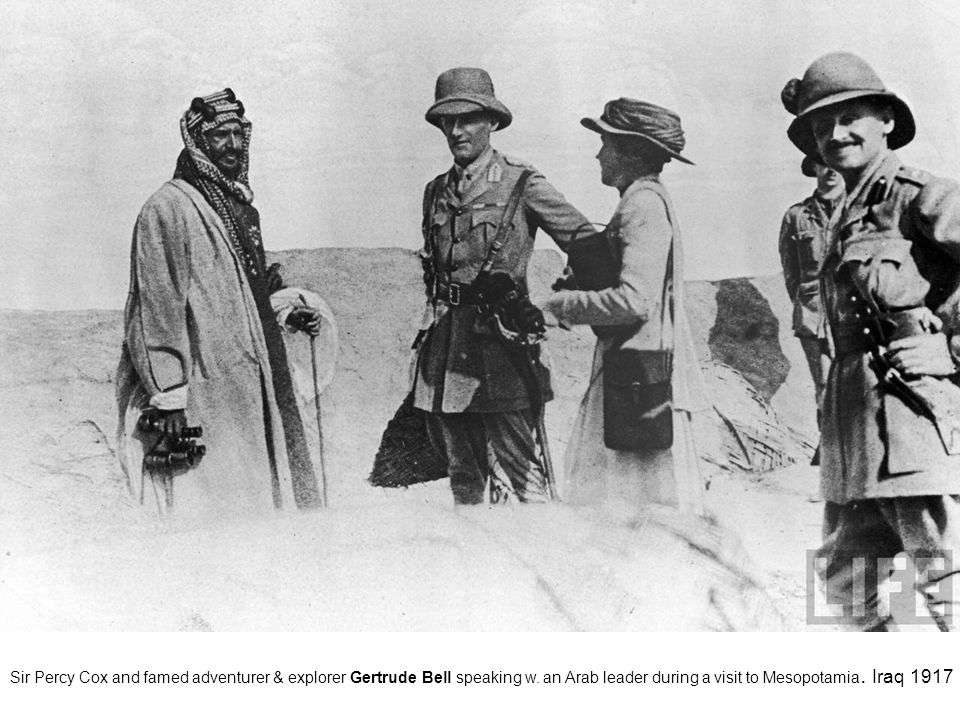 Sir Percy Cox and famed adventurer & explorer Gertrude Bell speaking w. an Arab leader during a visit to Mesopotamia. Iraq 1917