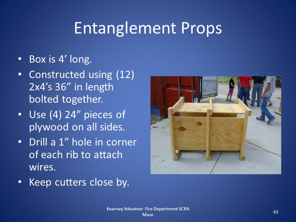 """Entanglement Props Box is 4' long. Constructed using (12) 2x4's 36"""" in length bolted together. Use (4) 24"""" pieces of plywood on all sides. Drill a 1"""""""