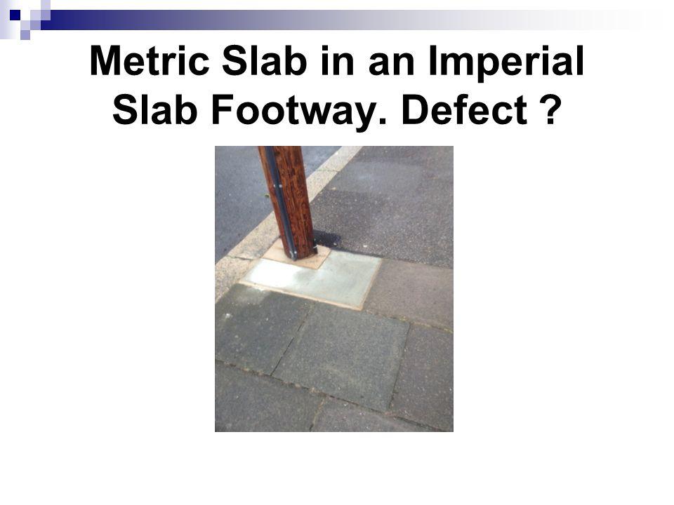 Metric Slab in an Imperial Slab Footway. Defect ?