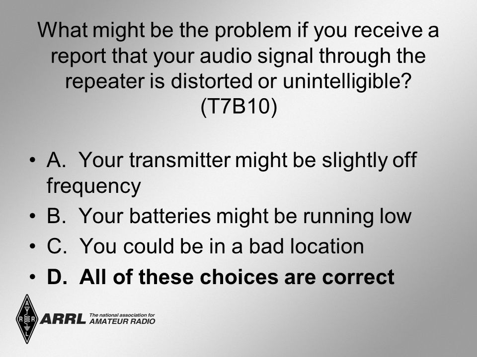 What might be the problem if you receive a report that your audio signal through the repeater is distorted or unintelligible.