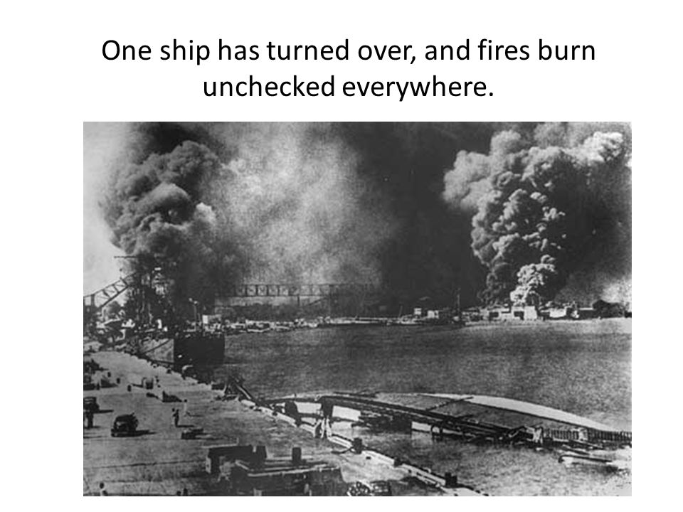 One ship has turned over, and fires burn unchecked everywhere.