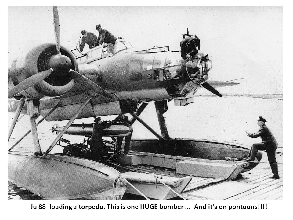Ju 88 loading a torpedo. This is one HUGE bomber... And it s on pontoons!!!!