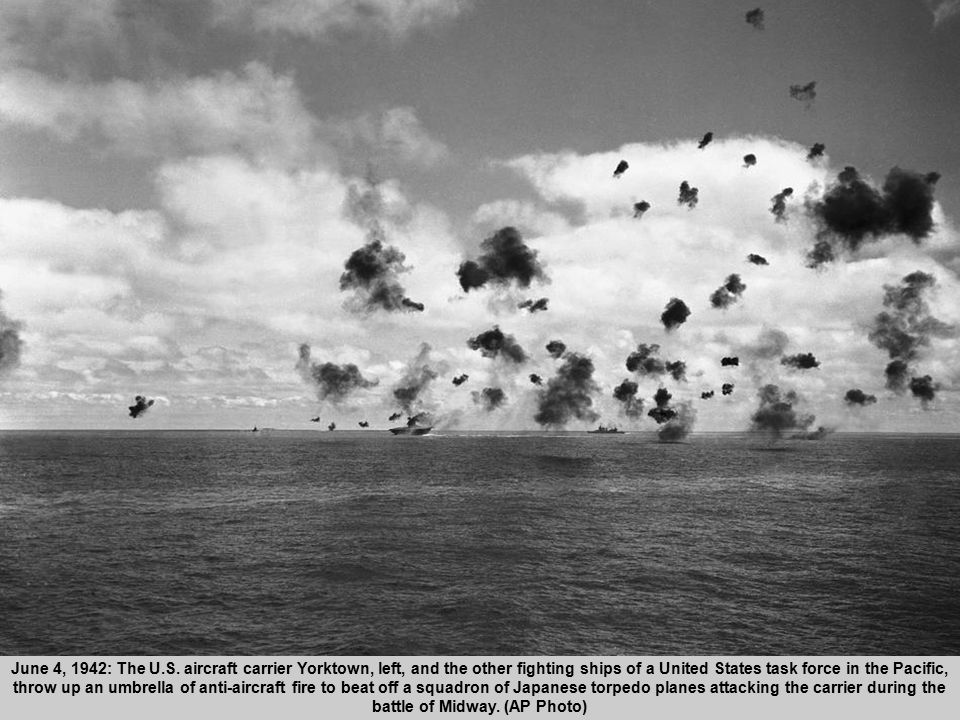 11 June 4, 1942: The U.S. aircraft carrier Yorktown, left, and the other fighting ships of a United States task force in the Pacific, throw up an umbr