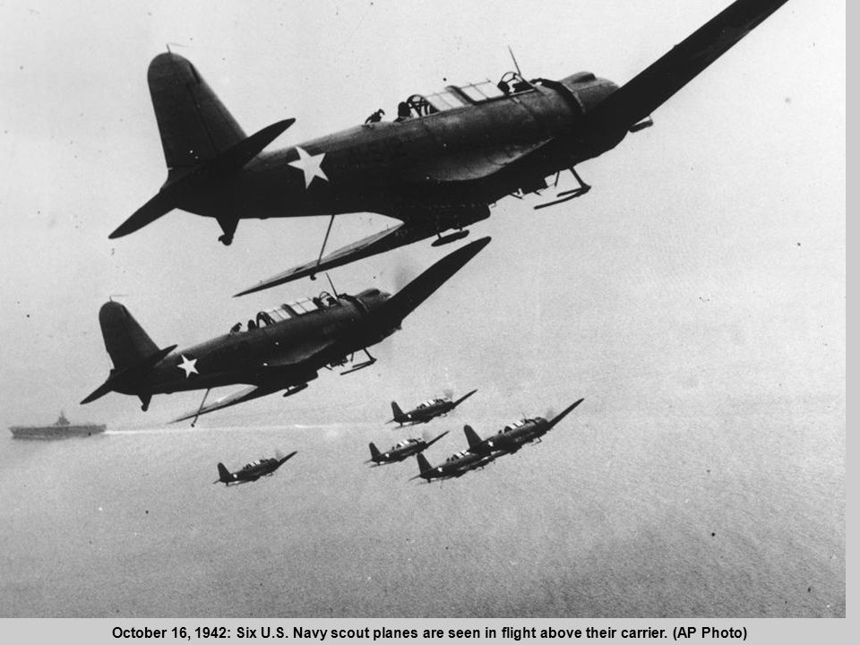19 October 16, 1942: Six U.S. Navy scout planes are seen in flight above their carrier. (AP Photo)