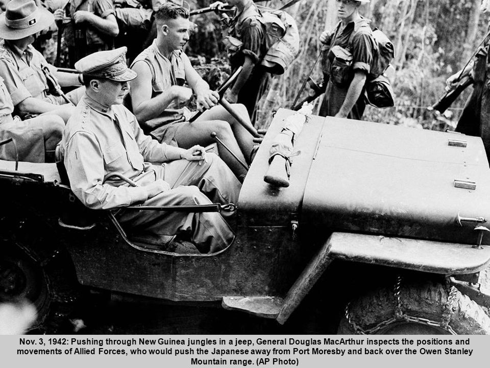 20 Nov. 3, 1942: Pushing through New Guinea jungles in a jeep, General Douglas MacArthur inspects the positions and movements of Allied Forces, who wo