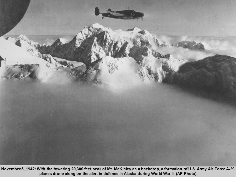 21 November 5, 1942: With the towering 20,300 feet peak of Mt.