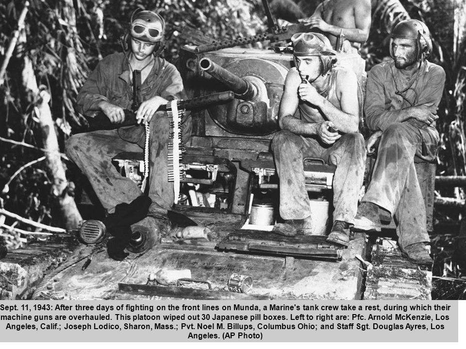 38 Sept. 11, 1943: After three days of fighting on the front lines on Munda, a Marine's tank crew take a rest, during which their machine guns are ove