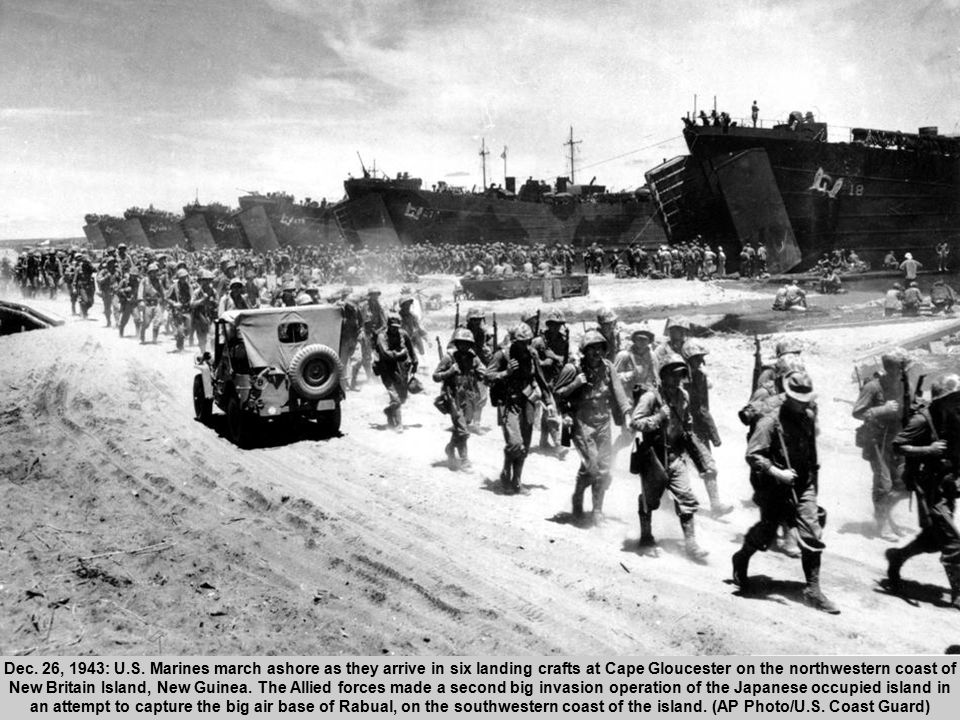 46 Dec. 26, 1943: U.S. Marines march ashore as they arrive in six landing crafts at Cape Gloucester on the northwestern coast of New Britain Island, N
