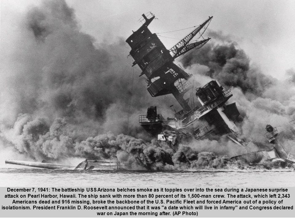 4 December 7, 1941: The battleship USS Arizona belches smoke as it topples over into the sea during a Japanese surprise attack on Pearl Harbor, Hawaii.