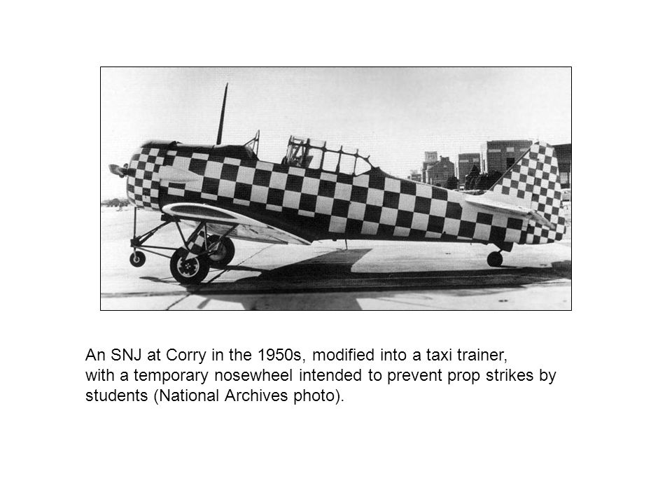 An SNJ at Corry in the 1950s, modified into a taxi trainer, with a temporary nosewheel intended to prevent prop strikes by students (National Archives photo).