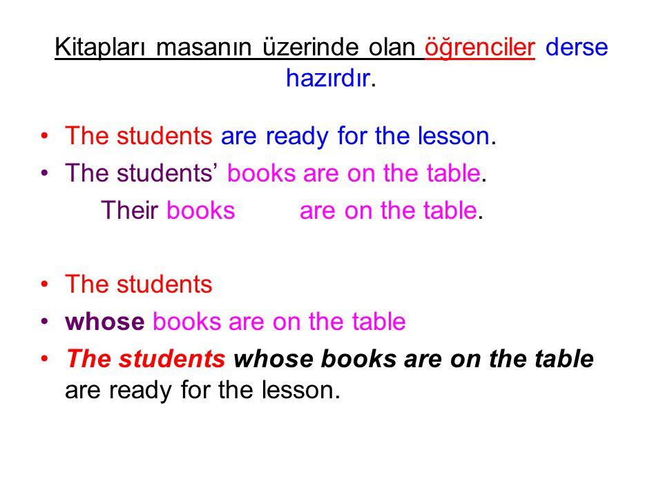 Kitapları masanın üzerinde olan öğrenciler derse hazırdır. The students are ready for the lesson. The students' books are on the table. Their books ar