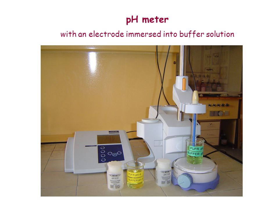 pH meter with an electrode immersed into buffer solution