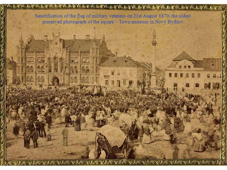 Famous promenade in the square in front of the pharmacy U Zlaté koruny, caught by the object-lens of Viktor Beneš (around 1895) – Town museum in Nový Bydžov.