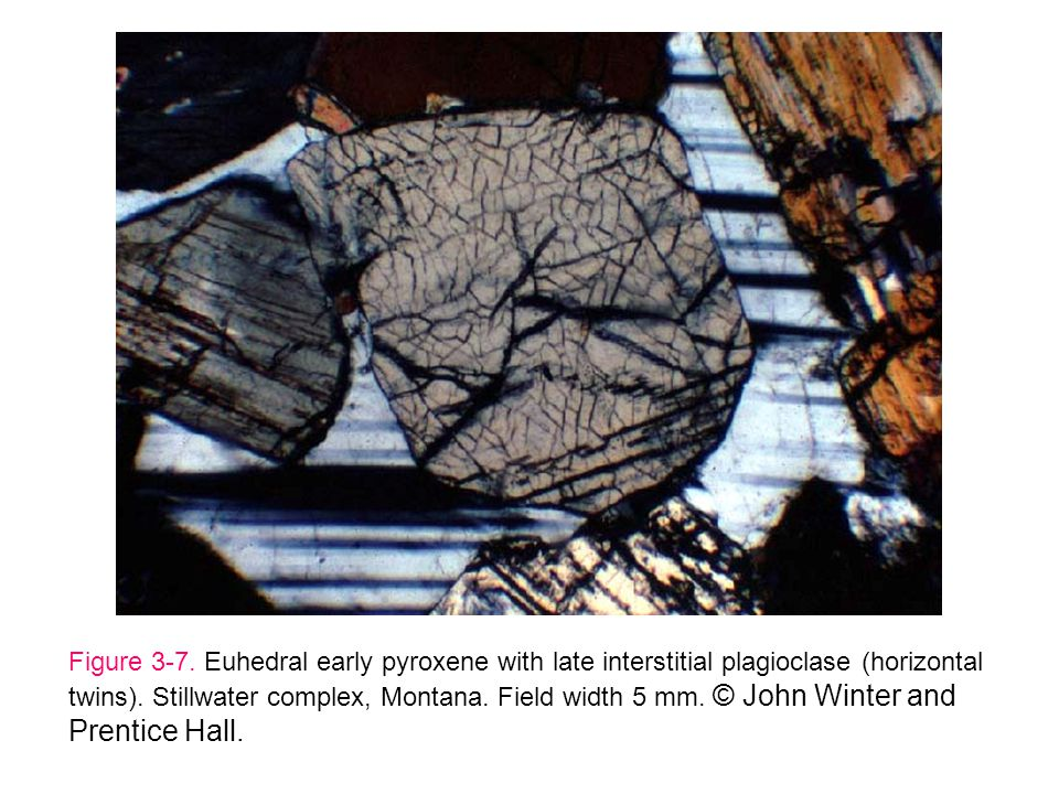 Figure 3-7. Euhedral early pyroxene with late interstitial plagioclase (horizontal twins). Stillwater complex, Montana. Field width 5 mm. © John Winte