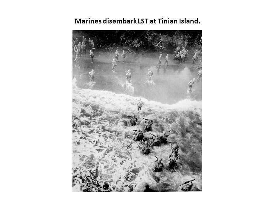 Marines disembark LST at Tinian Island.