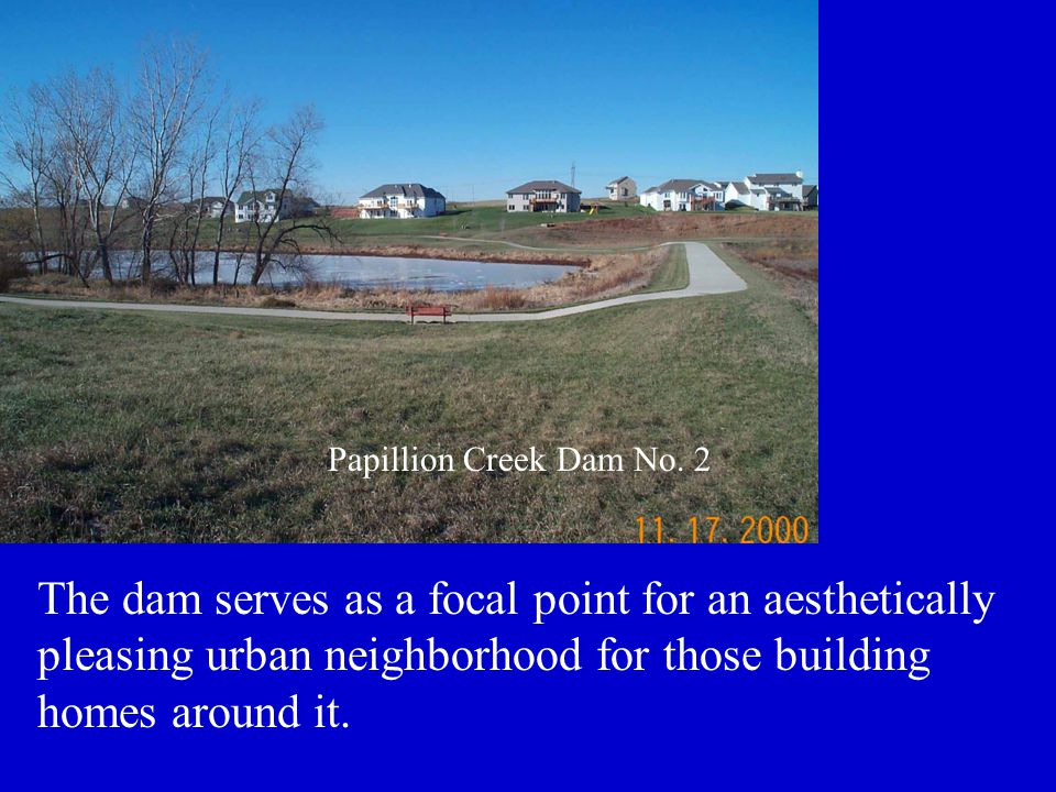 The dam serves as a focal point for an aesthetically pleasing urban neighborhood for those building homes around it. Papillion Creek Dam No. 2