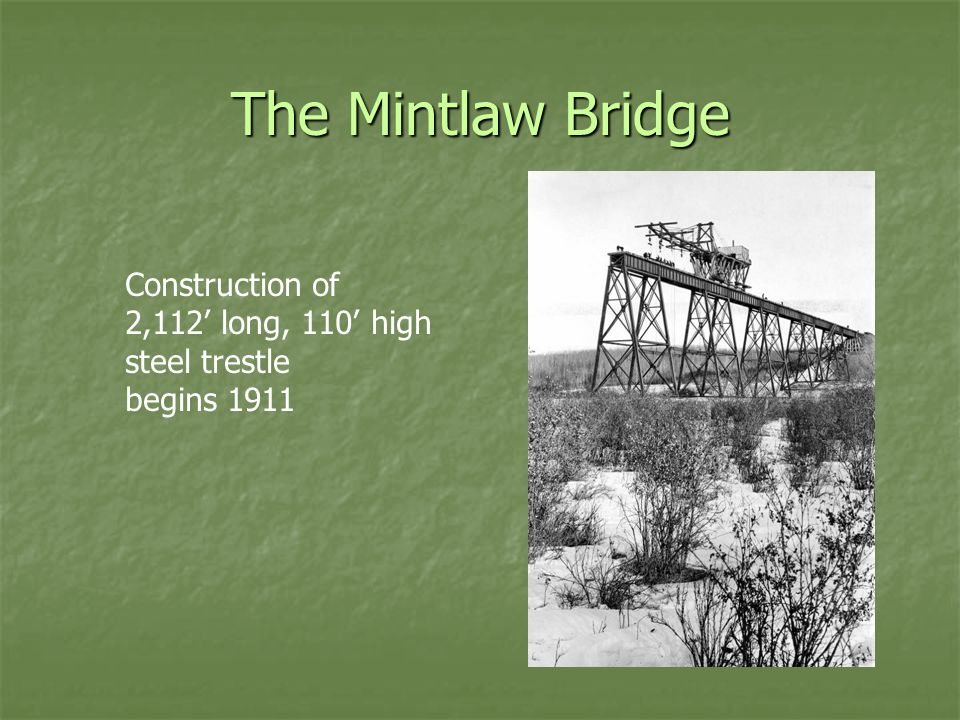 The Mintlaw Bridge Construction of 2,112' long, 110' high steel trestle begins 1911