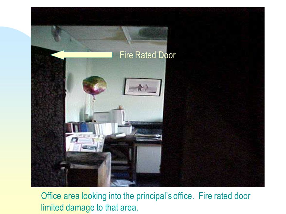 Office area looking into the principal's office. Fire rated door limited damage to that area.