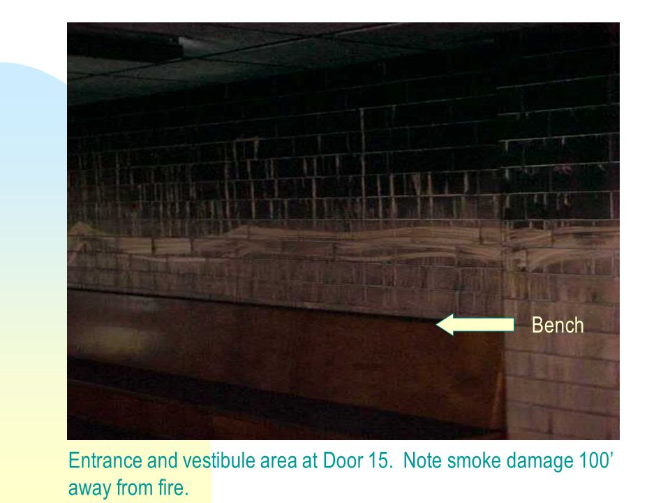 Entrance and vestibule area at Door 15. Note smoke damage 100' away from fire. Bench