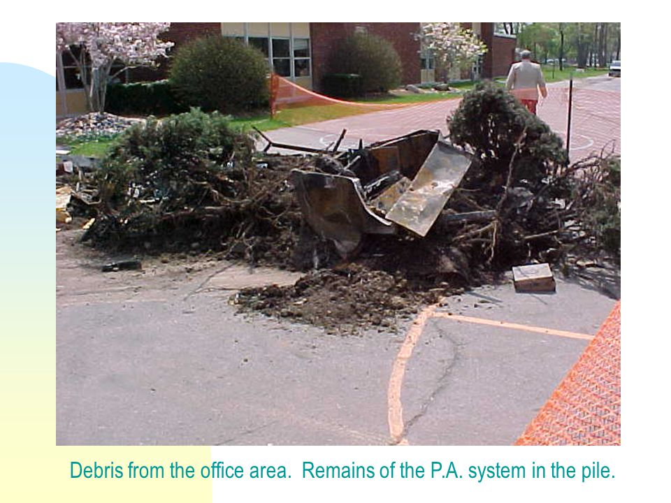 Debris from the office area. Remains of the P.A. system in the pile.