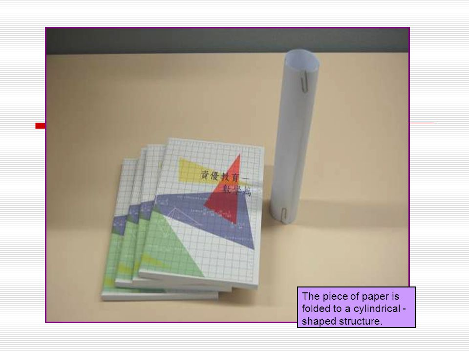 The piece of paper is folded to a cylindrical - shaped structure.