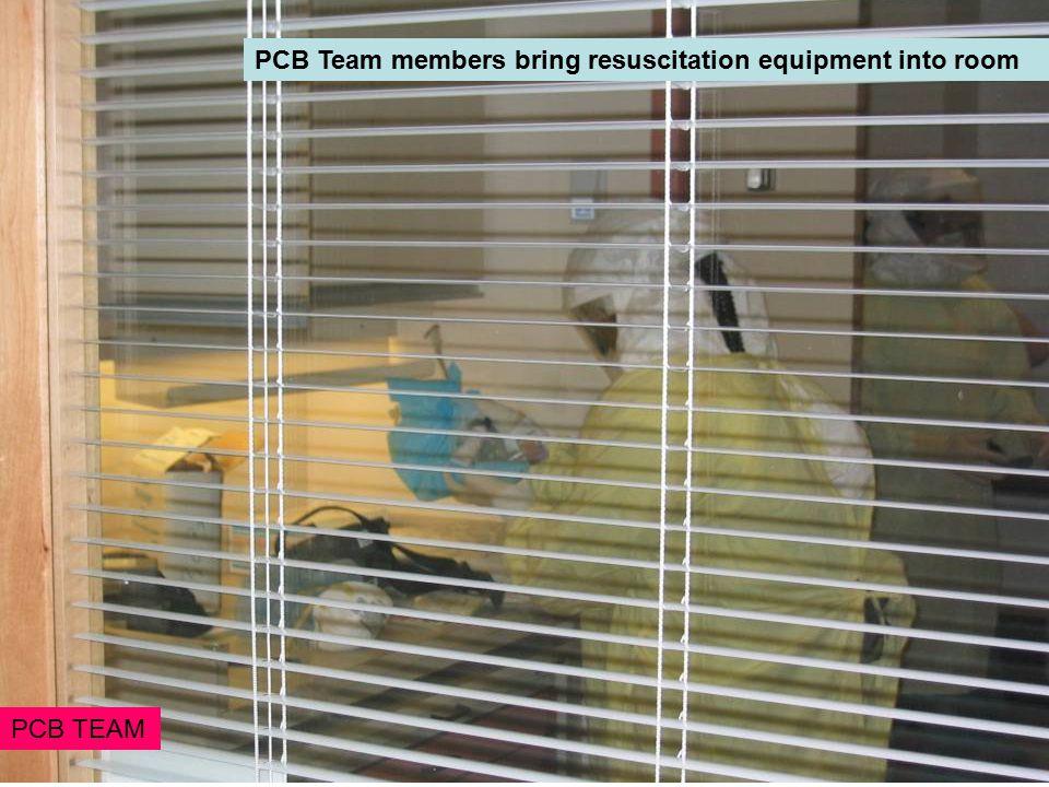 PCB Team members bring resuscitation equipment into room PCB TEAM