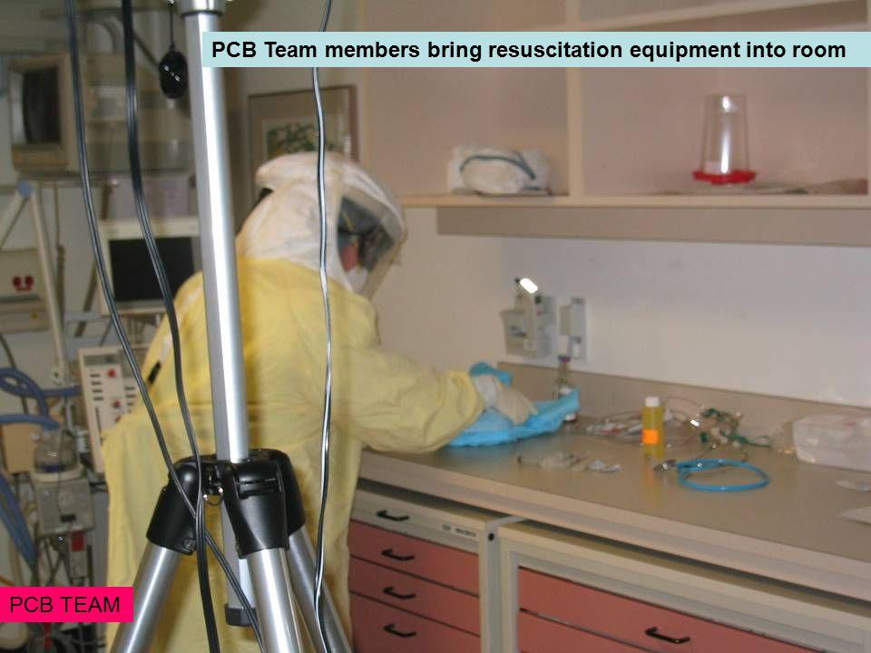 PCB Team members bring resuscitation equipment into room